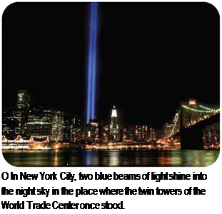 Подпись: О In New York City, two blue beams of light shine into the night sky in the place where the twin towers of the World Trade Center once stood.