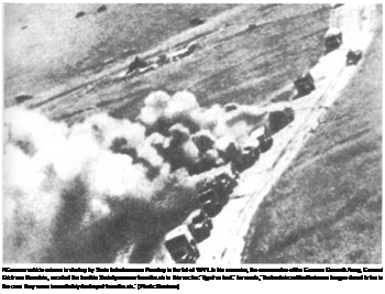 "Подпись: AGerman vehicle column is shot up by Soviet strafers near Perekop in the fall of 1941. In his memoirs, the commander of the German Eleventh Army, General Erich von Manstein, recalled the terrible Soviet pressure from the air in this sector: ""It got so bad."" he wrote, ""that antiaircraft batteries no llonger dared to fire in the case they were immediately destroyed from the air."" (Photo: Denisov.)"